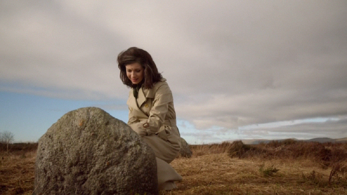Claire at Fraser grave, Culloden